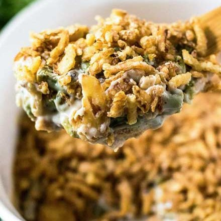 This green bean casserole is the classic holiday side dish everyone wants to see on the Thanksgiving table! Comforting, and SO easy to make... plus it's great to make ahead of time, making your holiday less stressful! #greenbean #casserole #Thanksgiving #sidedish #holiday #makeahead #easyrecipe