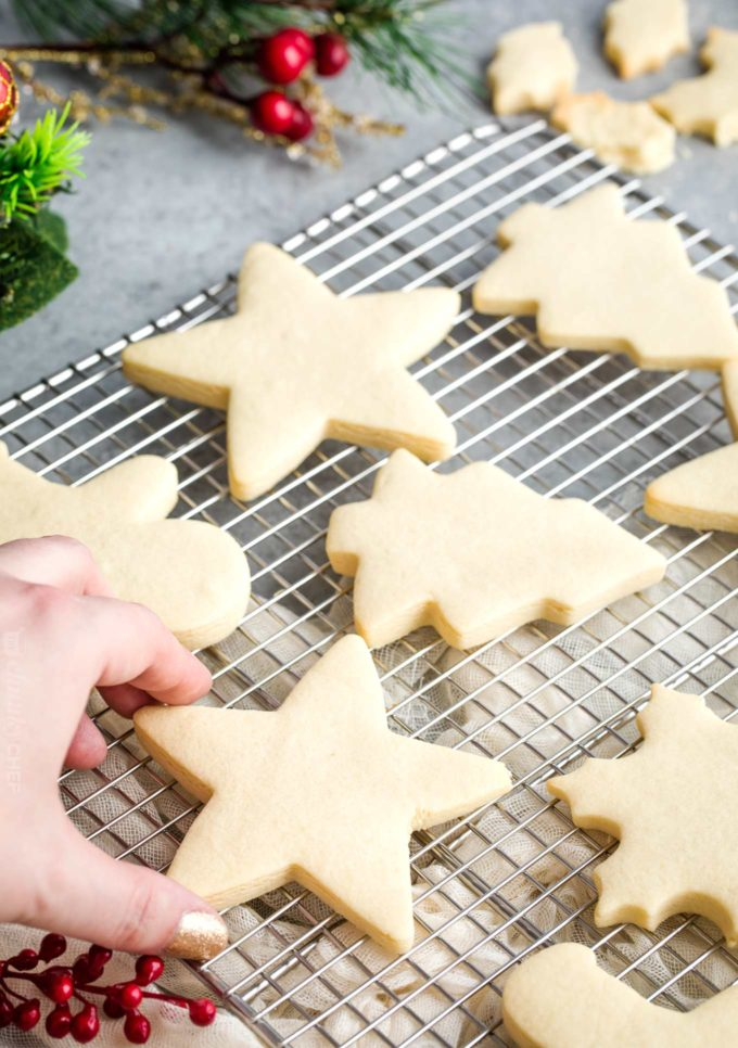 Cut out sugar cookies on cooling rack