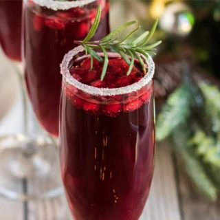 Refreshing and so quick and easy to make, these Pomegranate Mimosas are great for brunch, or a holiday party!  Tips on other flavor variations and how to make a pitcher for a large crowd! #mimosas #brunch #pomegranate #champagne #sparkling #holiday #cocktail #drinkrecipe