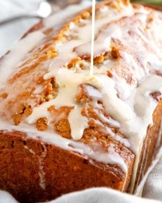 Quick bread recipe made with real eggnog, warming spices and rum, topped off with a sweet cinnamon rum glaze!  This holiday eggnog bread is perfect as a dessert, or holiday breakfast.  Makes one large loaf, or 3 smaller loaves. #eggnog #bread #quickbread #holidaybaking #christmas #bakingrecipe #dessert #breakfast