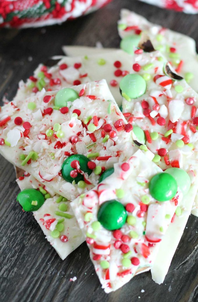 Holiday Peppermint Bark - the easiest, no-bake dessert made using simple ingredients like white chocolate and candy canes, and SO easy to customize for any holiday!  Great for Christmas dessert trays or to give away as holiday gifts! #dessert #nobake #easyrecipe #holiday #Christmas #peppermint #bark #white chocolate