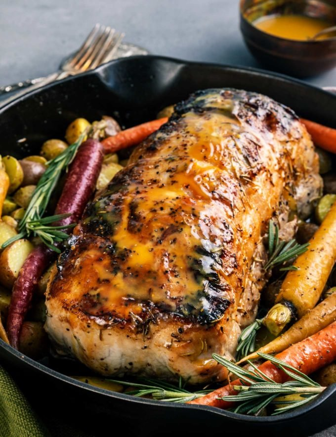 Perfect roasted pork loin recipe in cast iron pan with vegetables