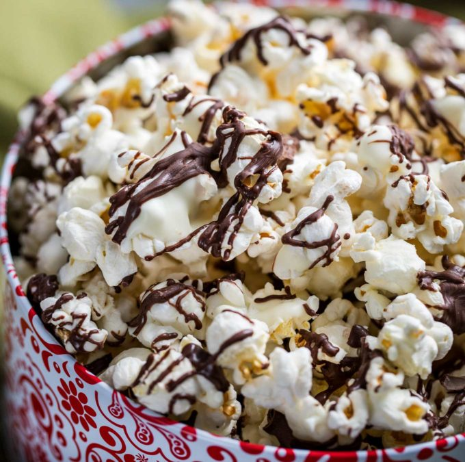 Chocolate covered popcorn in gift tin