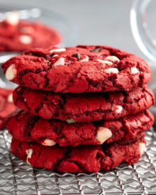 These Red Velvet Cake Mix Cookies are made using just 4 simple ingredients, and are on the cooling rack in 20 minutes - including prep time!  Great for Valentine's Day or when you need a quick dessert. #redvelvet #cakemix #cookies #baking #dessert #dessertrecipe #easyrecipe #valentinesday