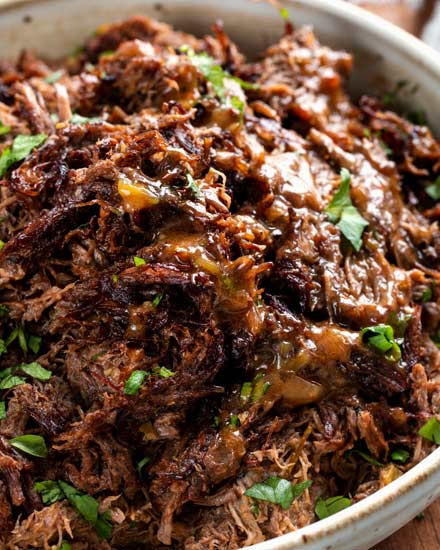 Truly melt-in-your-mouth tender and juicy, this beef barbacoa is loaded with bold flavors and ready for your tacos, burritos, bowls, or nachos!  Directions for pressure cooker, slow cooker, and the oven! #barbacoa #beef #mexican #shreddedbeef #cincodemayo #instantpot #pressurecooker #easyrecipe