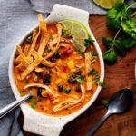 Bowl of soup on wood platter
