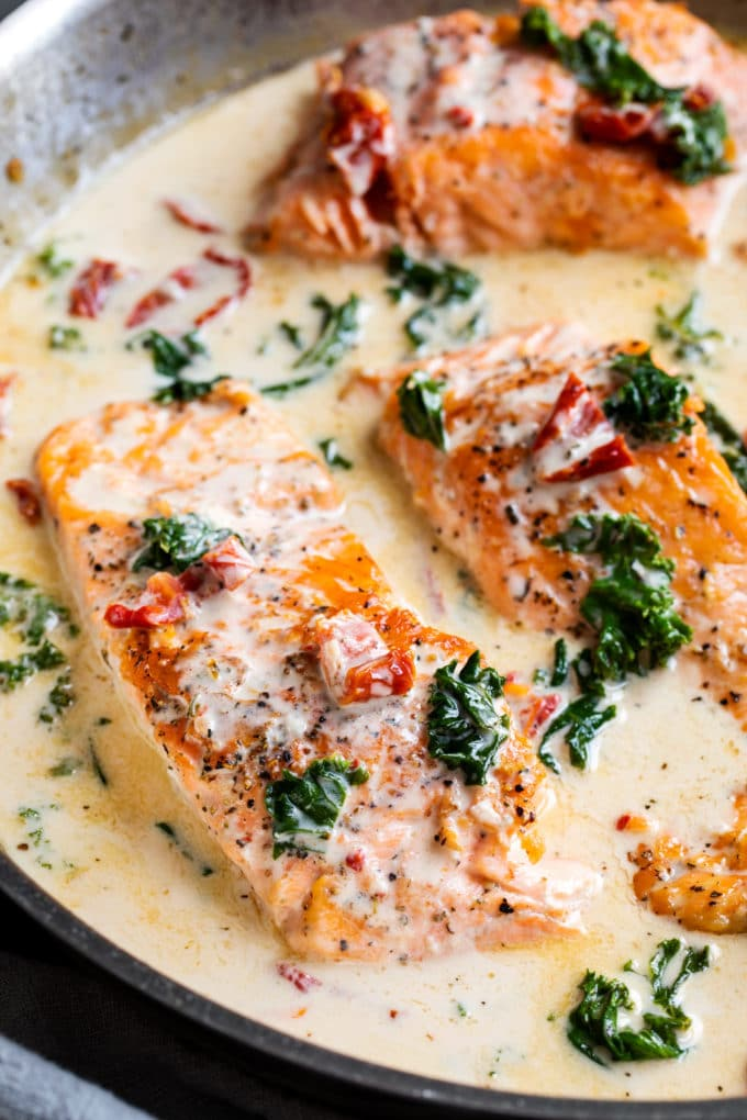 Tuscan salmon in cream sauce in skillet