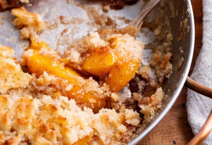 Scoop of peaches in skillet
