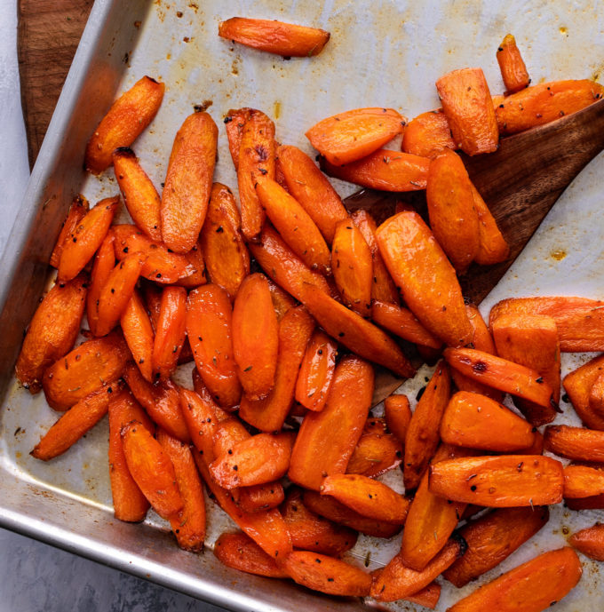 carrots on baking sheet with spatula