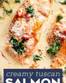 Tender salmon filets smothered in a rich garlic cream sauce filled with sun-dried tomatoes, kale and Parmesan cheese. Restaurant quality salmon, in 30 minutes! #salmon #seafood #fish #creamsauce #30minutemeal #easyrecipe #tuscan #Italian #sundriedtomatoes #kale #spinach