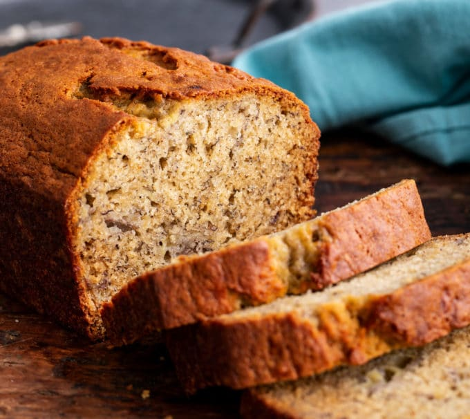 Loaf of banana bread partially sliced