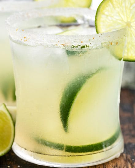 Homemade Classic Margarita recipe using just 4 simple ingredients.  You'll want to ditch that bottle of mix in no time.  This tequila cocktail is the perfect summer drink! #margaritas #tequila #lime #fresh #drink #cocktail #summer #cincodemayo