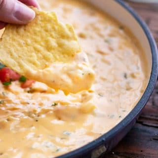 Chip with plenty of queso dip
