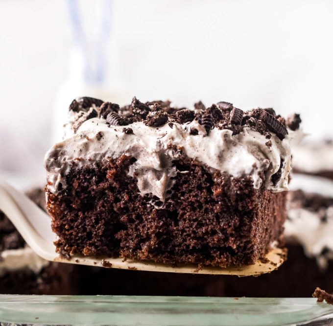 slice of chocolate oreo poke cake on spatula