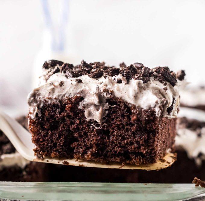 slice of chocolate oreo poke cake on spatula