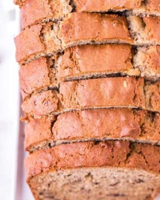 This Sour Cream Banana Nut Bread is ultra moist and tender, and a fantastic way to use up extra bananas! Made with no mixer, in 1 bowl, and ready in 1 hour... it's the perfect easy quick bread recipe! #banana #bananabread #banananut #baking #bread #quickbread #loaf #easyrecipe #dessert