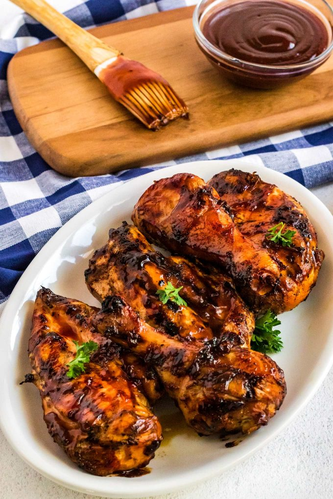 bbq chicken on white oval plate