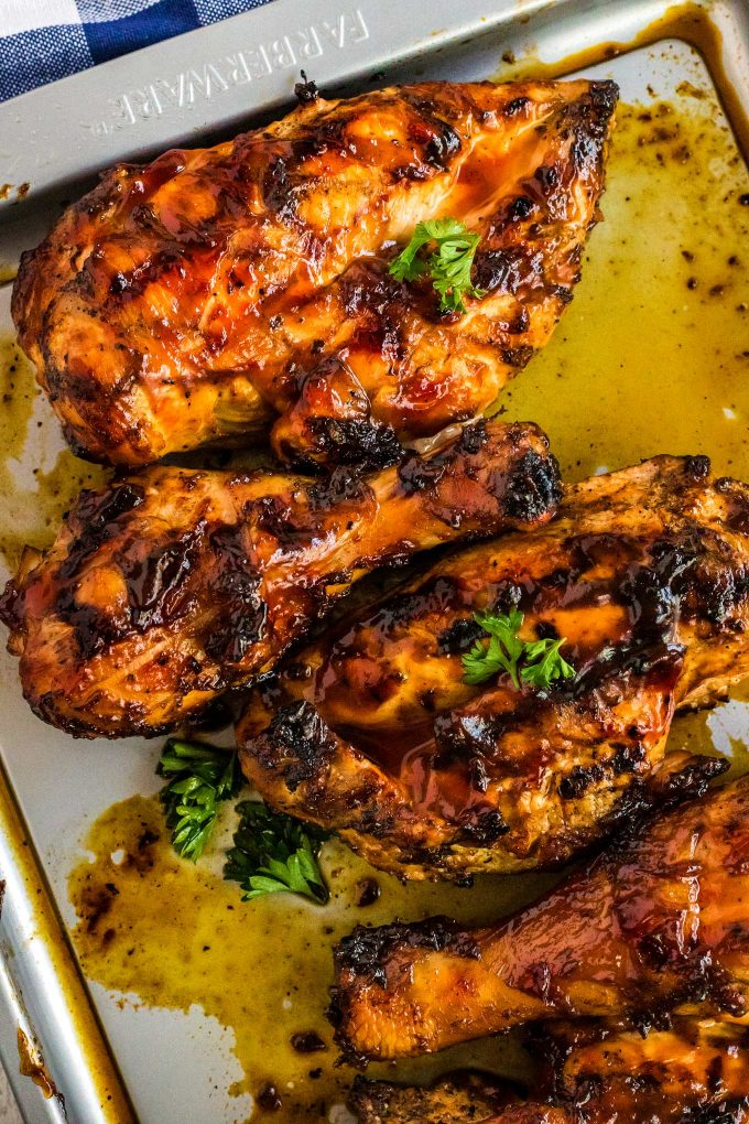 Hands down the BEST juicy Grilled BBQ Chicken!  With an optional quick brine and flavorful spice rub, this chicken is already bursting with flavor before you even add the bbq sauce! #chicken #bbq #barbecue #grilled #grilling #summer #grillout #cookout #dinner