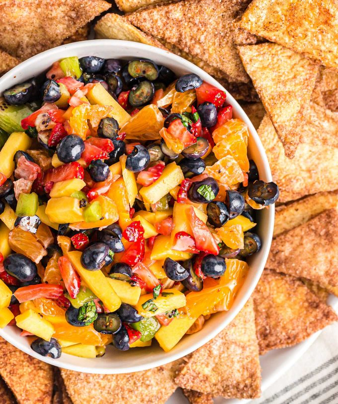 bowl of fruit salsa surrounded by cinnamon chips