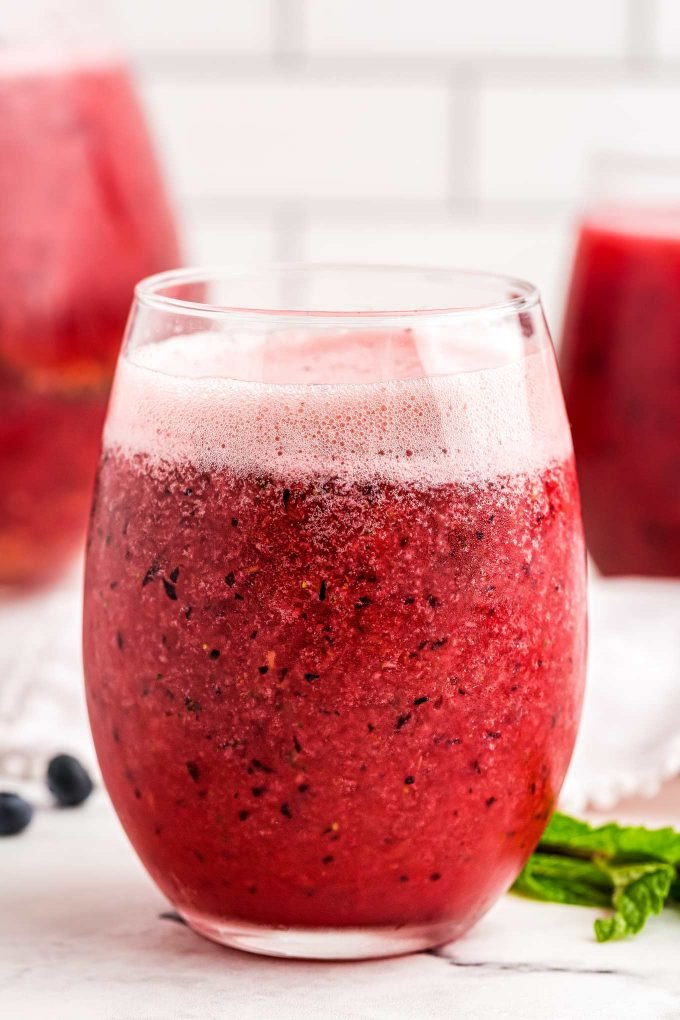 Delicious and refreshing fizzy fruit punch that is great for any party.  Uses just 4 ingredients, and is easy to make alcoholic if you want! #punch #fruit #mixedberry #berry #party #drink #beverage #summer