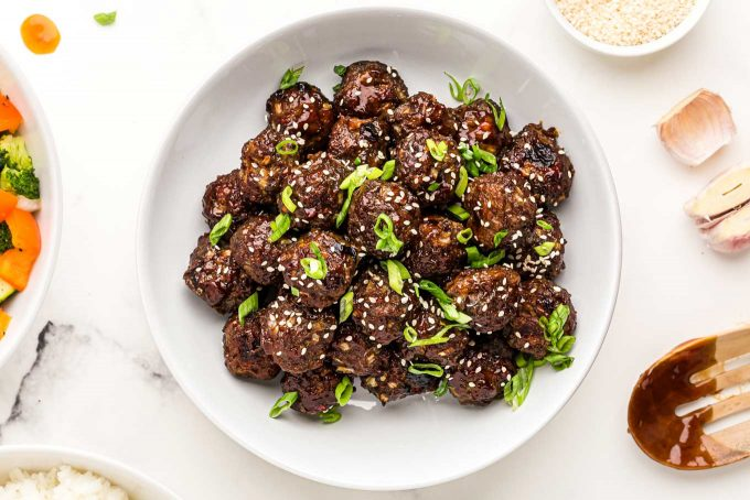 bowl of thai meatballs with green onions