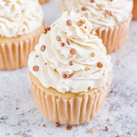 Group of vanilla cupcakes with rose gold sprinkles