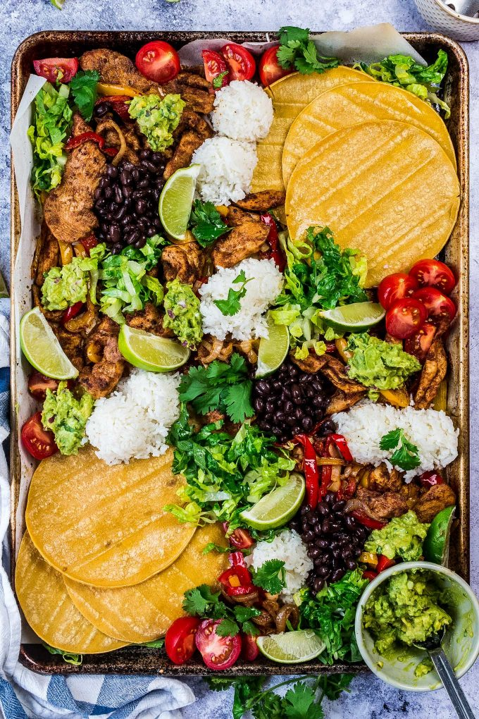 All the flavor of chicken fajitas, made easily on one sheet pan! For a delicious dinner idea, add your favorite toppings right on the sheet pan and let your family make their own fajita tacos!