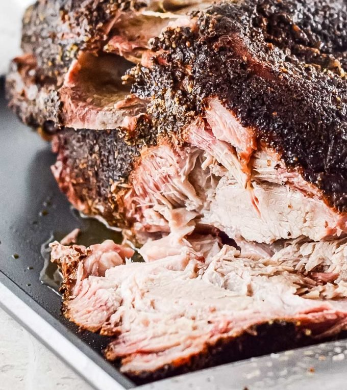Ultra flavorful and tender, this Pork Shoulder is smoked low and slow, and creates the most amazing, melt in your mouth pulled pork!  Step by step how to smoke pork shoulder recipe.