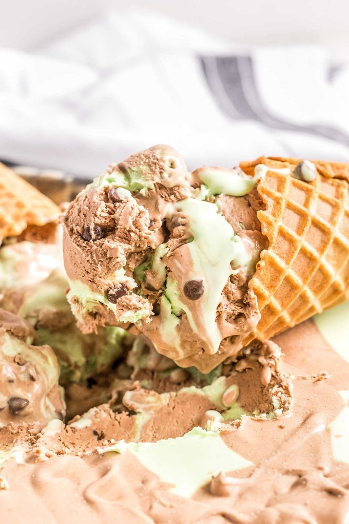 This chocolate mint ice cream is the perfect blend of sweet chocolate, icy mint, and silky creaminess.  Amazing homemade ice cream, made with NO ice cream maker, is the best dessert ever! #icecream #mint #chocolate #nochurn #dessert #sweets #frozen
