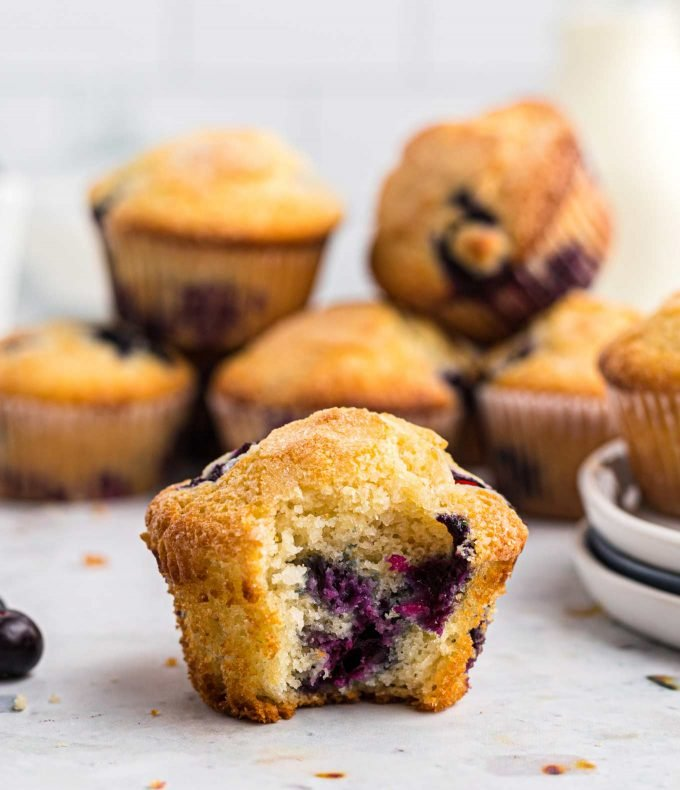 blueberry muffin with a bite taken out of it