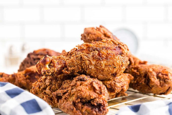 pile of fried chicken on cooling rack