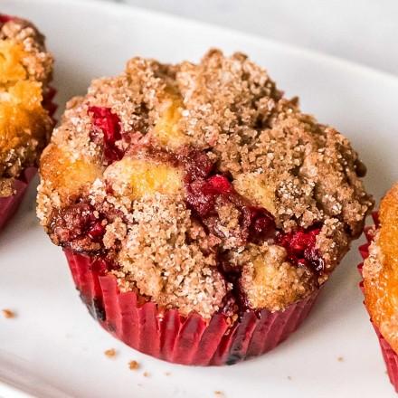 cranberry orange muffin on white plate