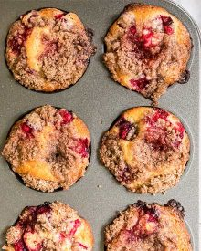 These Cranberry Orange Muffins are made with tart cranberries, bright orange zest, and sweet freshly squeezed orange juice folded gently into a thick and rich classic muffin batter. Perfect for the holidays, school mornings, or anytime! #muffins #cranberry #orange #breakfast #dessert #easyrecipe #baking