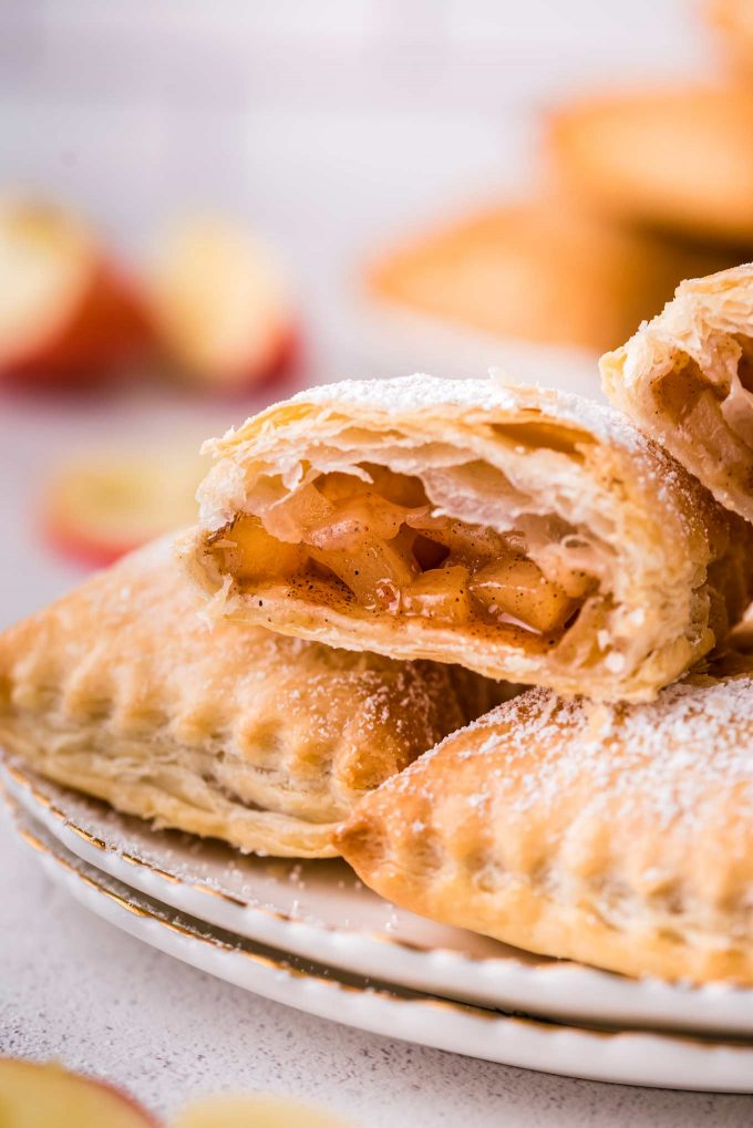 turnover cut in half showing apple cinnamon filling