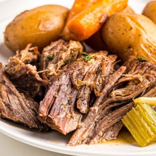 beef and vegetable pot roast on white plate