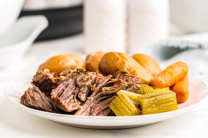 pot roast with vegetables on white plate