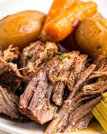 Juicy, melt-in-your-mouth beef, tender vegetables and an ultra flavorful gravy make for the perfect Pot Roast recipe! Classic comfort food meets family friendly dinner, made with the ease of the Instant Pot! #potroast #beef #instantpot #pressurecooker #dinner #comfortfood #potroastrecipe