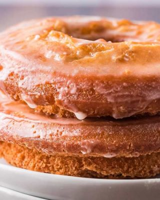 Golden brown on the outside and soft and fluffy on the inside, these Old Fashioned Sour Cream Donuts are made with simple ingredients and NO yeast! Perfectly fried with nooks and crannies to hold the sweet vanilla glaze! #donuts #cakedonuts #oldfashioned #sourcream #baking #breakfast #pastry