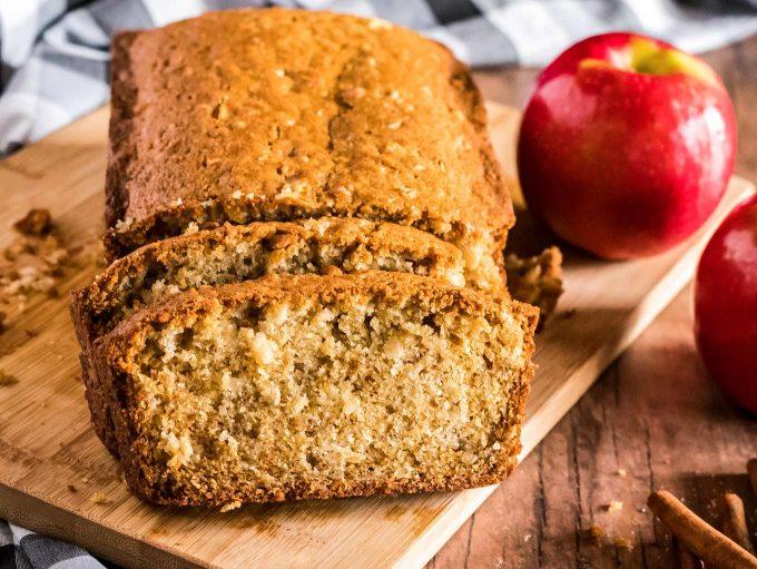 Loaf of apple cinnamon bread sliced on a cutting board