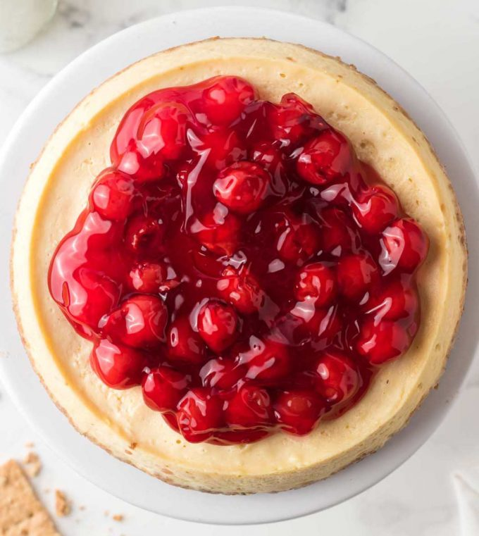 instant pot cheesecake topped with cherries