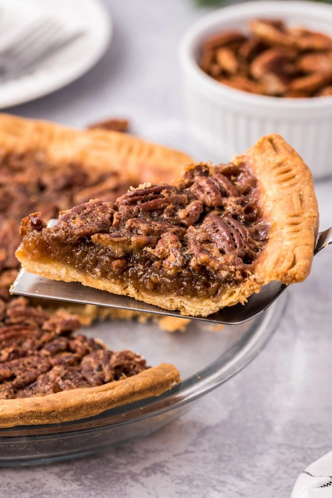 serving up a slice of pecan pie from pie pan