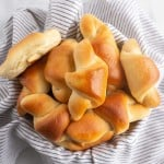 bread basket filled with crescent rolls