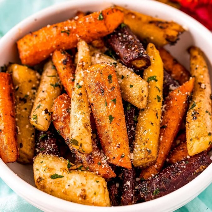 white bowl with roasted carrots inside