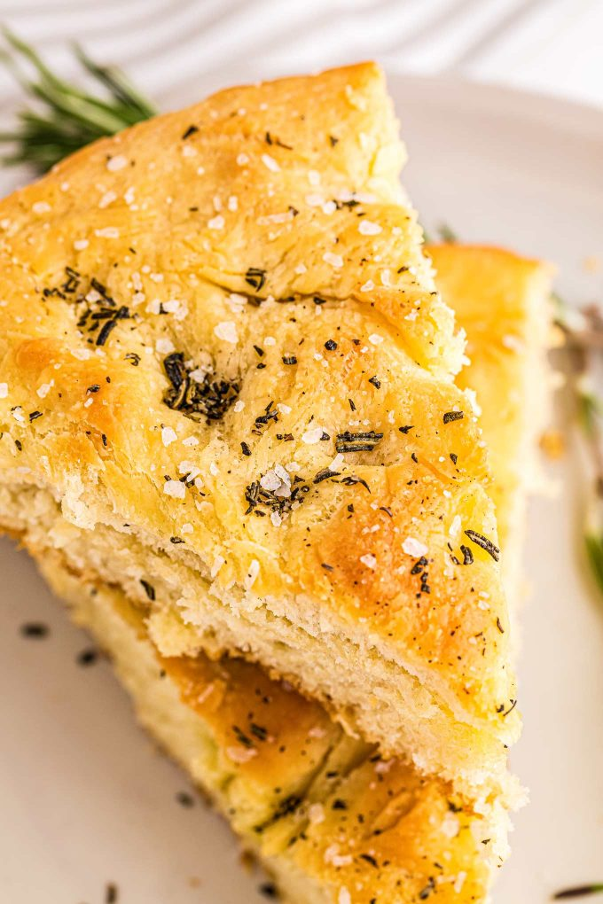 two slices of rosemary focaccia on top of each other