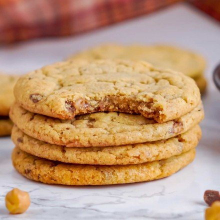 stack of pumpkin cookies, one with a bite taken out of it