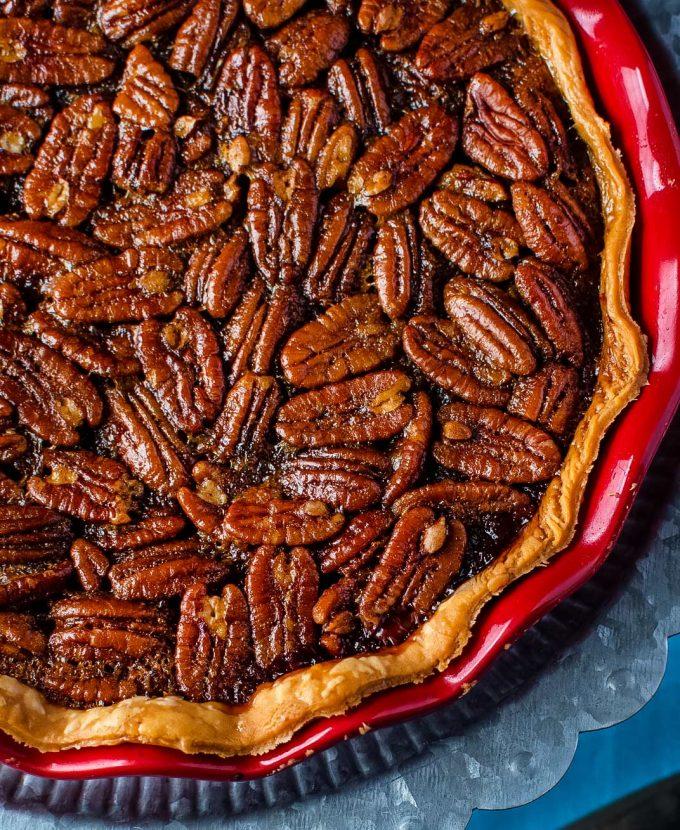bourbon pecan pie in red pie pan