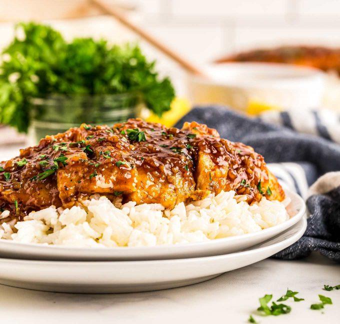 sliced honey garlic chicken on rice