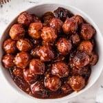 bowl of honey garlic crockpot meatballs in sauce