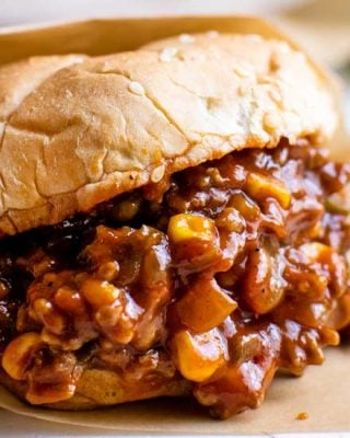 Perfect for a quick dinner, these Tex-Mex Sloppy Joes are ready in 30 minutes or less!  Made with beef, jalapenos, corn, and zesty spices, these sloppy joes will soon become a new family favorite! #sloppyjoes #texmex #easyrecipe #dinner #kidfriendly #sandwich #onepan #weeknight
