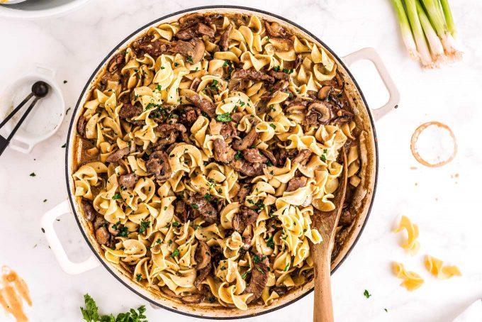 beef stroganoff in skillet with egg noodles